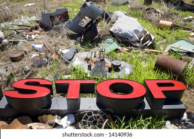 """Word """"STOP"""" lying amongst junk and garbage."""