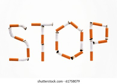 "Word ""Stop"" made of cigaret stubs"