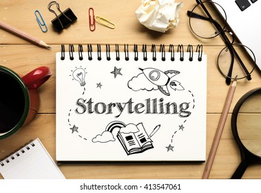 """The word """"Storytelling"""" on notebook and wooden desk background (Business Concept)"""