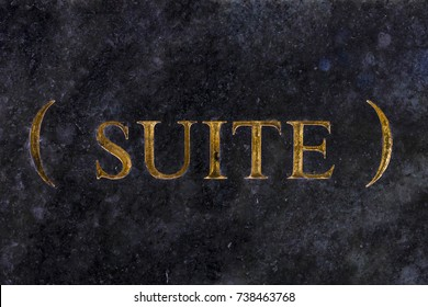 """The word """"suite"""", engraved in gold letters on marble."""