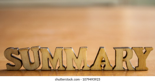 The word 'summary' made of wooden letters. wood inscription on table
