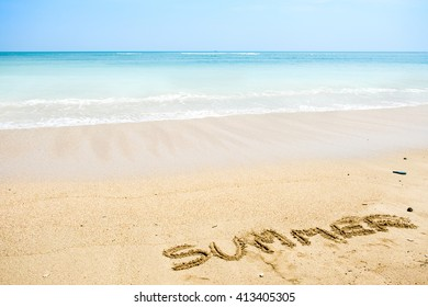 """The word with """"Summer"""" in the sand against the sea"""