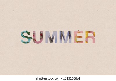The word SUMMER written on light brown paper showing some typical summer items - mint leaves, cold refreshing drink, sprigs of lavender, pear and lemons
