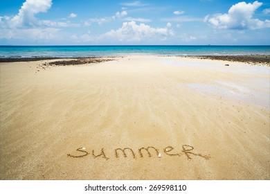 word summer is written on the send, beach view