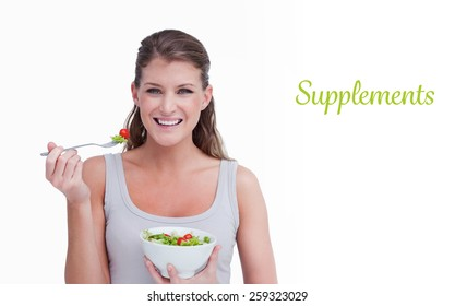 The word supplements against woman eating a salad