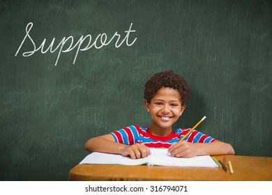The word support and smiling pupil against green chalkboard