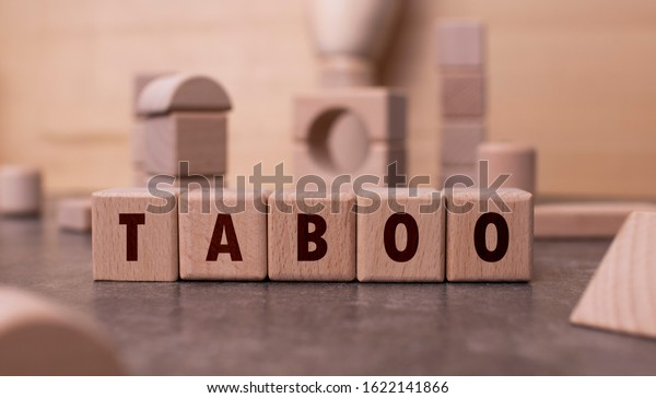 "Word ""Taboo"" written with wooden blocks"