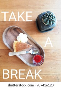 "Word ""TAKE A BREAK"" with strawberry cheesecake and castus ,flat lay view"