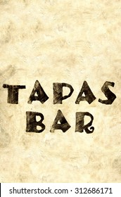 word tapas bar parinted on a house wall