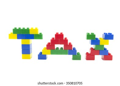 word TAX with colorful building blocks isolated on white background