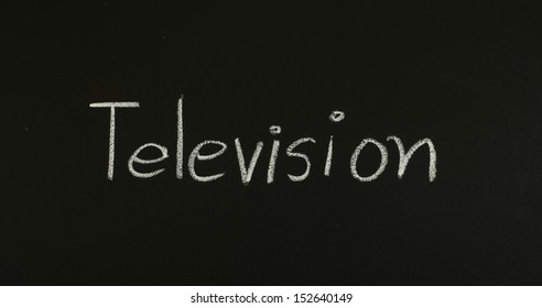 "word ""television"" written on blackboard"
