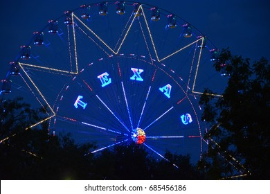 The word Texas on a Ferris wheel in a Dallas park and events ground.