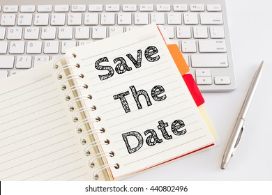 Word text Save the date on white paper on office table / business concept