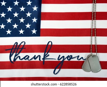 word thank you and military dog tags on American flag background