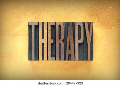 The word therapy written in vintage letterpress type