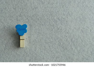 The word three on a colorful peg on a white background