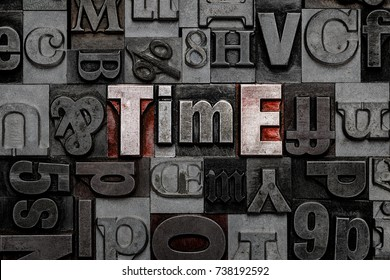 The word Time made from old metal letterpress letters.