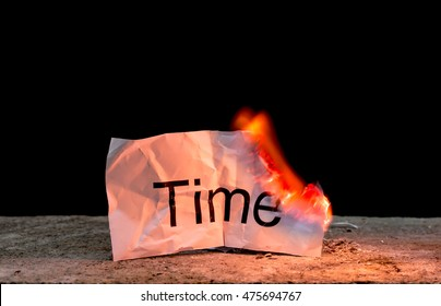 "Word ""time"" on burning crumpled paper with idea ""don't waste your time """