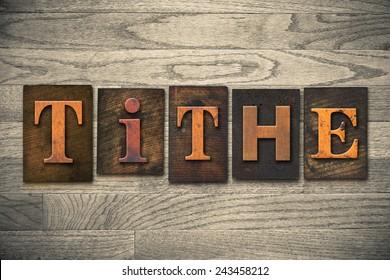 """The word """"TITHE"""" written in wooden letterpress type."""
