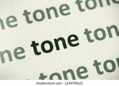 word tone printed on white paper macro