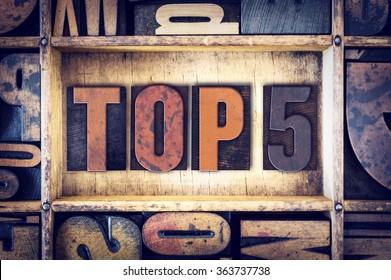 """The word """"Top 5"""" written in vintage wooden letterpress type."""
