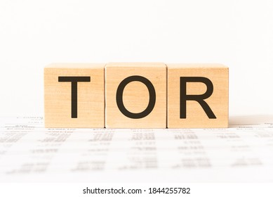 Word tor. Wooden small cubes with letters isolated on white background with copy space available.Business Concept image.