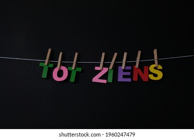 Word Tot Ziens on black background.Tot Ziens means good bye in Dutch . Concept for art, learning, and education.
