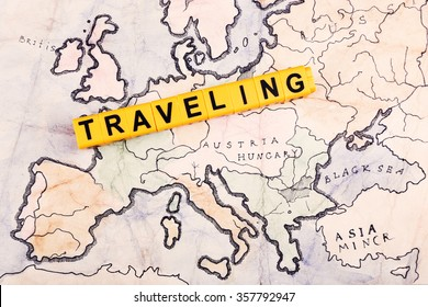 word traveling on world map background stock photo edit now