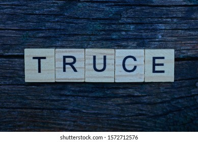 word truce made from brown wooden letters lies on a gray background