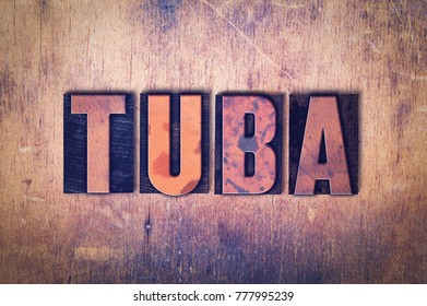 The word Tuba concept and theme written in vintage wooden letterpress type on a grunge background.
