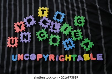 Word uncopyrightable on black background. Uncopyrightable defines as not able or allowed to be protected by copyright