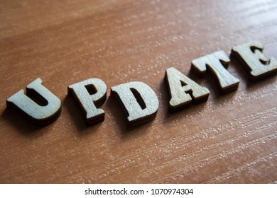 The word 'update' made of wooden letters. wood inscription