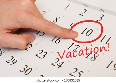 The word vacation is written and circled on a white calendar page