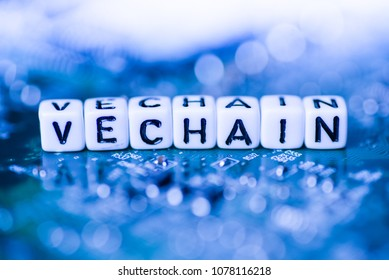 Word VECHAIN formed by alphabet blocks on mother cryptocurrency