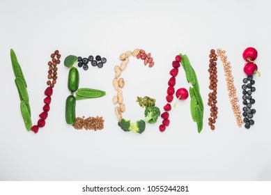 """Word """"Vegan"""" shaped from plant based food, top view"""