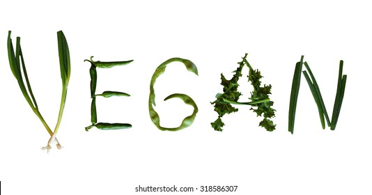 The word vegan spelled out with green vegetables