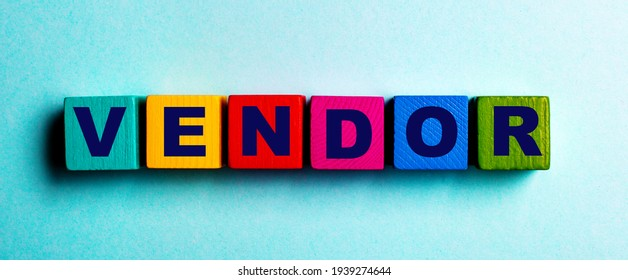 The word VENDOR is written on multicolored bright wooden cubes on a light blue background