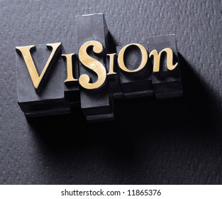 """The word """"Vision"""" photographed using vintage lead typeset characters."""