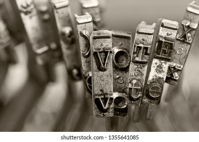 the word   VOTE with old typwriter keys  monochrome
