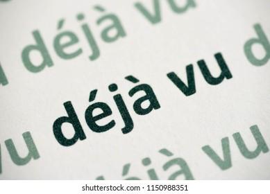 word déjà vu printed on white paper macro