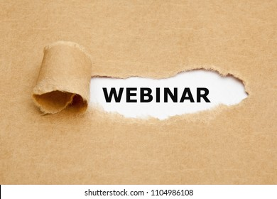 The word Webinar appearing behind torn brown paper.