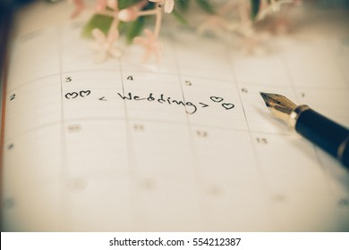 word wedding writing free hand on calendar