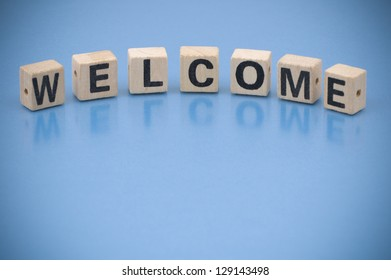The word WELCOME made of letters on wooden blocks