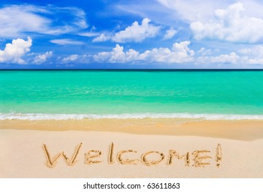 Word Welcome on beach - vacation concept background