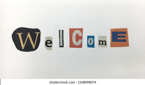 """The word """"Welcome""""in cut out letters blackmail style in white background"""