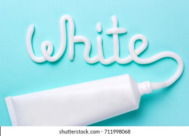 The word white is from the toothpaste. Tube for cleaning teeth and whitening