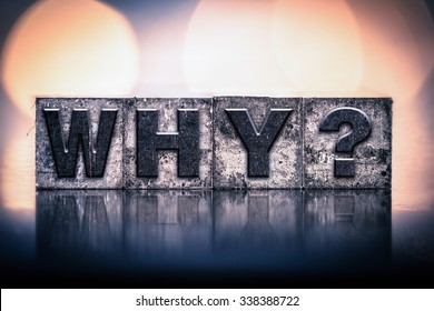 "The word ""WHY"" written in vintage ink stained letterpress type."