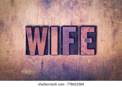 The word Wife concept and theme written in vintage wooden letterpress type on a grunge background.