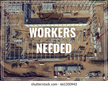 Word Workers Needed over industrial place from above.
