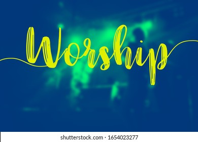 "The word of ""Worship"" and the hall in church christian music concert.Blurred background of people raised hands and shouting worship concert.Christian background for worship.Duo tone."
